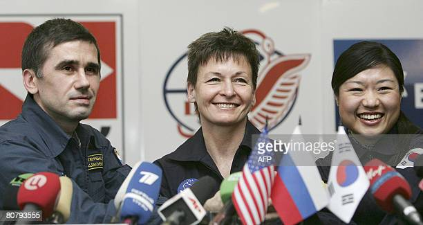 Yury Malenchenko of Russia Peggy Whitson of the US and South Korean Yi SoYeon hold a press conference outside Moscow in Star City on April 21 2008...