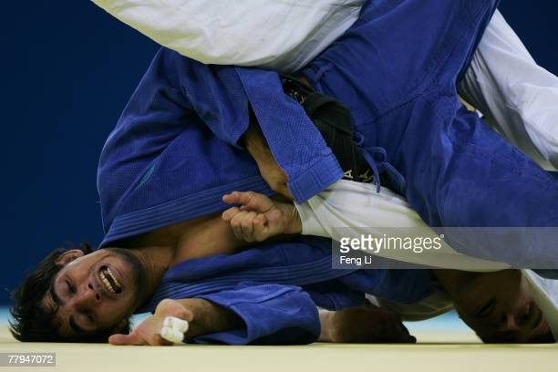 Yury Panasenkov of Russia competes with Antonio Ciano of Italy in the men's 81kg category during the Good Luck Beijing 2007 Judo Open at the...