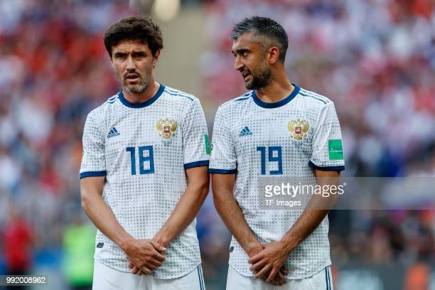 Yury Zhirkov of Russia and Alexander Samedov of Russia look on during the 2018 FIFA World Cup Russia match between Spain and Russia at Luzhniki...