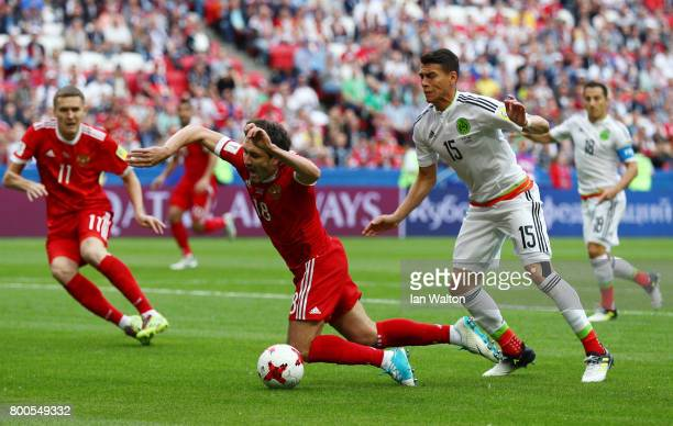 Yury Zhirkov of Russia is fouled by Clayton Lewis of New Zealand during the FIFA Confederations Cup Russia 2017 Group A match between Mexico and...