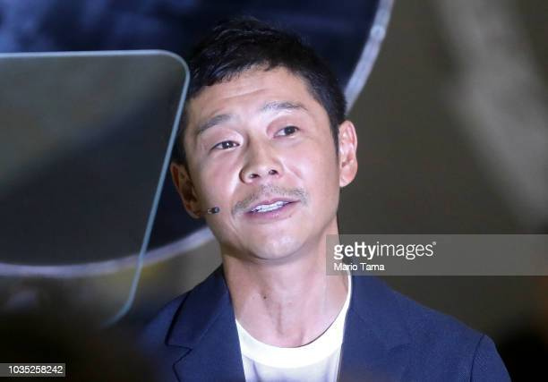 Yusaka Maezawa the Japanese billionaire chosen by SpaceX CEO Elon Musk to fly around the moon listens to a question at SpaceX headquarters on...