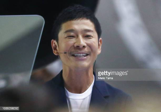 Yusaka Maezawa the Japanese billionaire chosen by SpaceX CEO Elon Musk to fly around the moon smiles at SpaceX headquarters on September 17 2018 in...