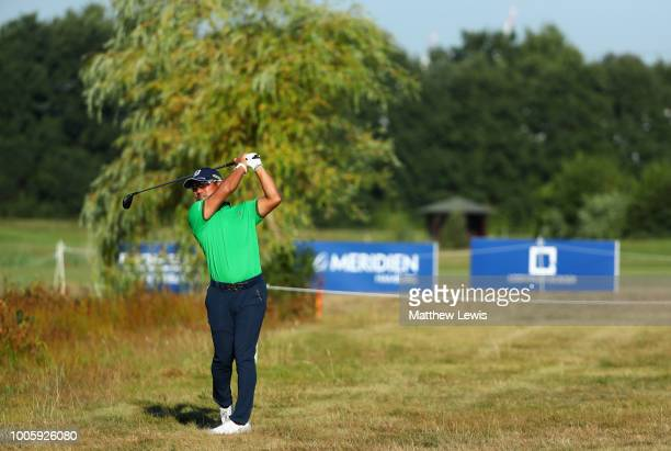 Yusako Miyazato of Japan plays his second shot on the 11th hole during day two of the Porsche European Open at Green Eagle Golf Course on July 27...