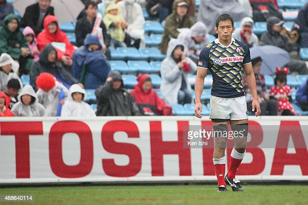 Yusaku Kuwazuru of Japan looks on in the game between Japan and Fiji during day two of the Tokyo Sevens Rugby 2015 at Chichibunomiya Rugby Stadium on...