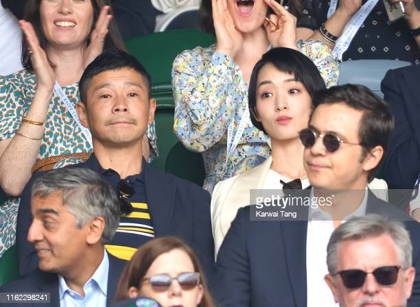 Yusaku Maezawa and Ayame Goriki on Centre Court on Men's Finals Day of the Wimbledon Tennis Championships at All England Lawn Tennis and Croquet Club...