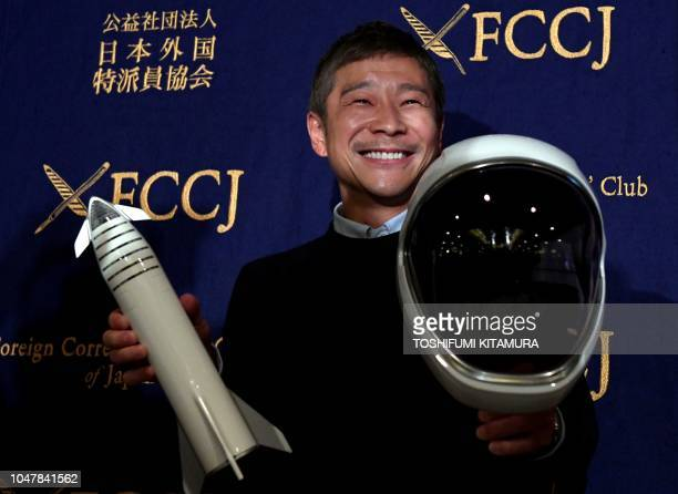 TOPSHOT Yusaku Maezawa entrepreneur and CEO of ZOZOTOWN and SpaceX BFR's first private passenger poses with a miniature rocket and space helmet prior...