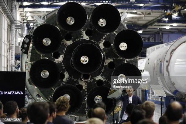 Yusaku Maezawa founder and president of Start Today Co gestures as he speaks during an event at the SpaceX headquarters in Hawthorne California US on...