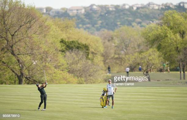 Yusaku Miyazato of Japan plays a shot on the second hole during the first round of the World Golf ChampionshipsDell Match Play at Austin Country Club...
