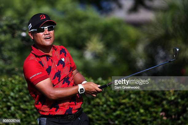 Yusaku Miyazato of Japan plays his shot from the 15th tee during the first round of the Sony Open In Hawaii at Waialae Country Club on January 14...