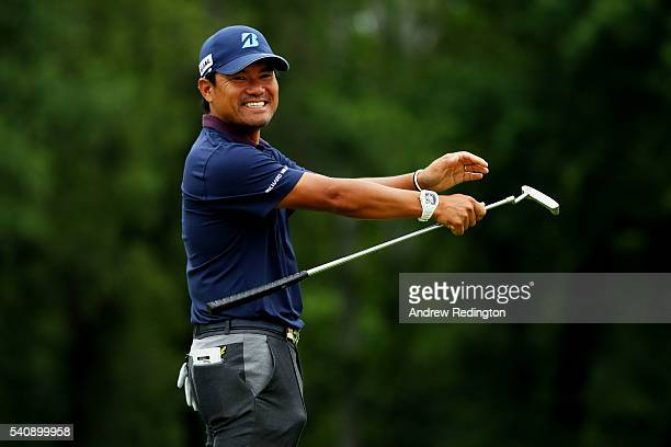 Yusaku Miyazato of Japan plays his shot from the 16th tee during the continuation of the weather delayed first round of the US Open at Oakmont...