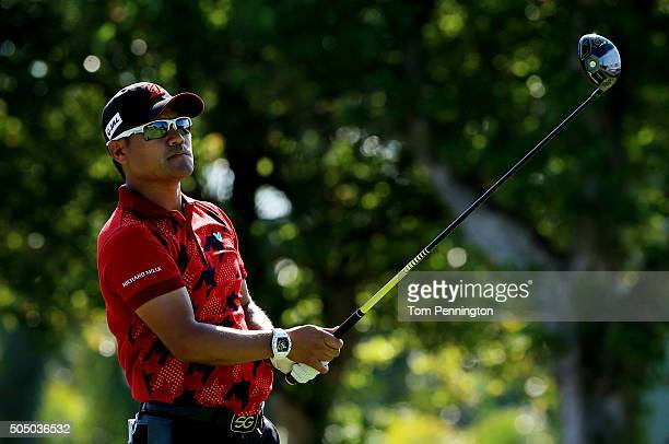Yusaku Miyazato of Japan plays his shot from the first tee during the first round of the Sony Open In Hawaii at Waialae Country Club on January 14...