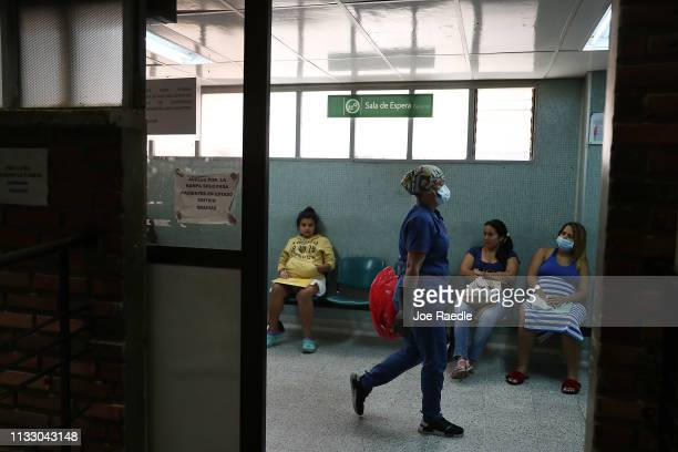 Yusbey Anteliz originally from Venezuela and Eddy Zulay Gonzalez originally from Venezuela relax in the waiting area of the maternity ward of the...