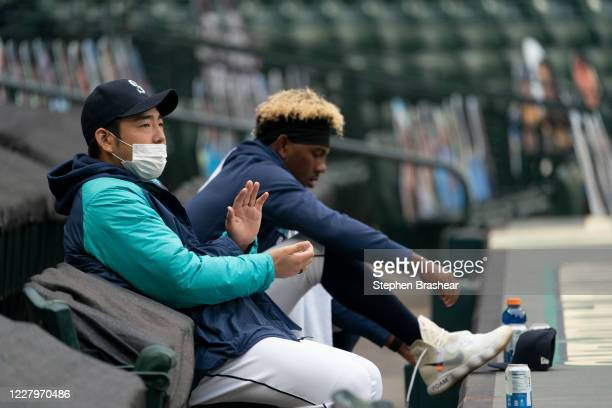 Yusei Kikuchi of the Seattle Mariners applauds from the stands as the team takes field before a game against the Colorado Rockies at T-Mobile Park on...