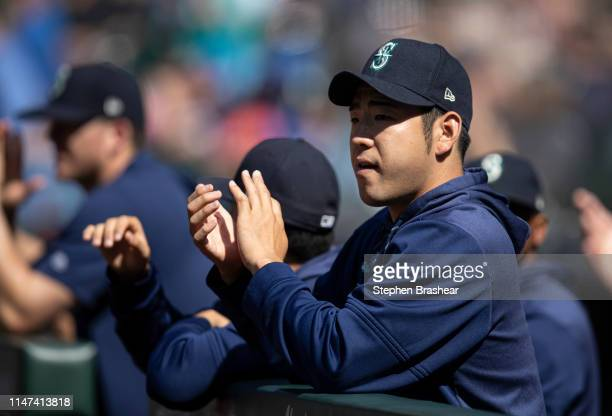 Yusei Kikuchi of the Seattle Mariners applauds while standing in the dugout before a game against the Los Angeles Angels at TMobile Park on June 1...