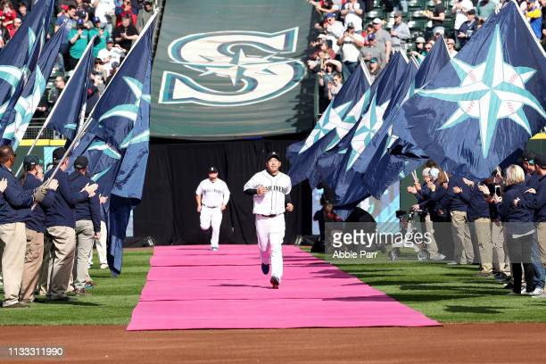 Yusei Kikuchi of the Seattle Mariners is introduced to the starting lineup prior to taking on the Boston Red Sox during their Opening Day game at...