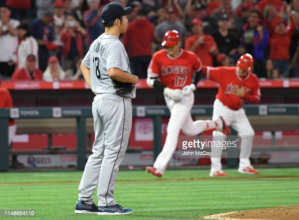 Yusei Kikuchi of the Seattle Mariners looks on as Shohei Ohtani of the Los Angeles Angels of Anaheim rounds thrid base after hitting a home run in...