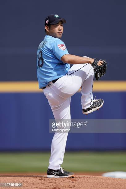 Yusei Kikuchi of the Seattle Mariners pitches during a spring training game against the Cincinnati Reds at Peoria Stadium on February 25 2019 in...