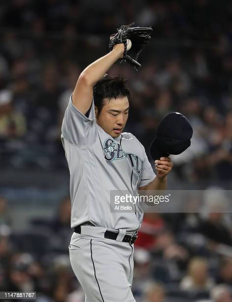 Yusei Kikuchi of the Seattle Mariners reacts after giving up a hit in the sixth inning by Mike Tauchman of the New York Yankees during their game at...