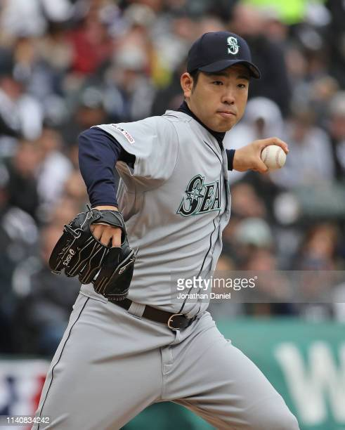 Yusei Kikuchi of the Seattle Mariners throws to first base against the Chicago White Sox during the season home opening game at Guaranteed Rate Field...