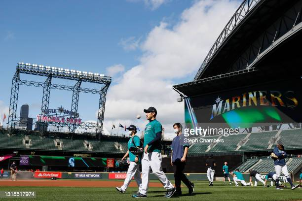 Yusei Kikuchi of the Seattle Mariners walks to the dugout before the game against the Los Angeles Angels at T-Mobile Park on April 30, 2021 in...
