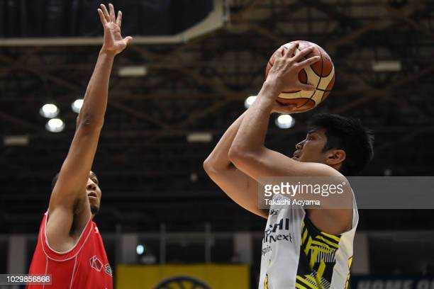 Yusei Sugiura of Sun Rockers Shibuya shoots while under pressure from Aki Chambers of Chiba Jets during the B.League Early Cup Kanto 3rd Place Game...