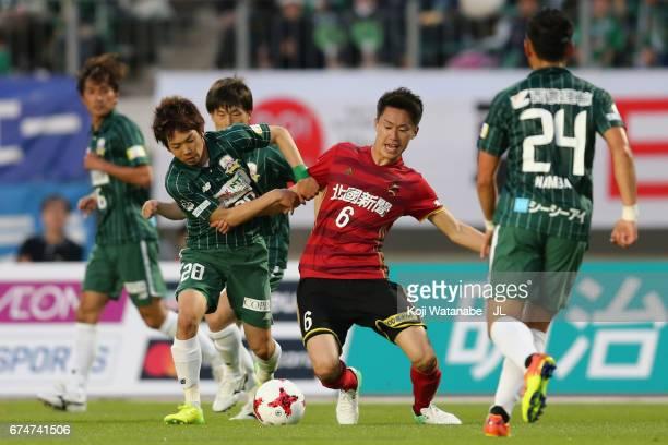 Yushi Nagashima of FC Gifu and Hisashi Ohashi of Zweigen Kanagawa compete for the ball during the JLeague J2 match between FC Gifu and Zweigen...