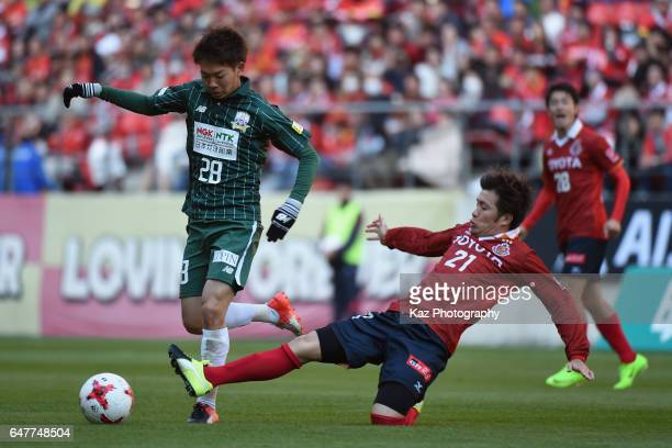 Yushi Nagashima of FC Gifu is tackled by Kohei Hattanda of Nagoya Grampus during the JLeague J2 match between Nagoya Grampus and FC Gifu at Toyota...