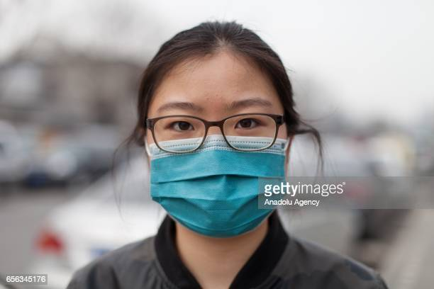 Yushi Yuan 25 years old from Beijing poses for a portrait at Xinjiekou East Road in Beijing China on March 22 2017 Heavy smog has become a major...