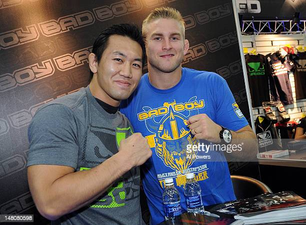 Yushin Okami and Alexander Gustafsson pose for a photo during the UFC Fan Expo at the Mandalay Bay Convention Center on July 7, 2012 in Las Vegas,...