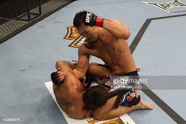Yushin Okami def. Lucio Linhares - TKO - 2:47 round 2 during UFC Fight Night 21 at Bojangles Coliseum on March 31, 2010 in Charlotte, North Carolina.