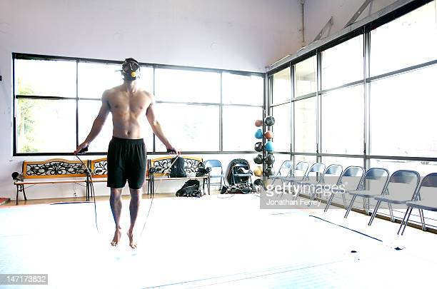 Yushin Okami jumps roe with a gas mask on to simulate higher altitude during a workout at the Team Quest gym on June 26 2012 in Tualatin Oregon...