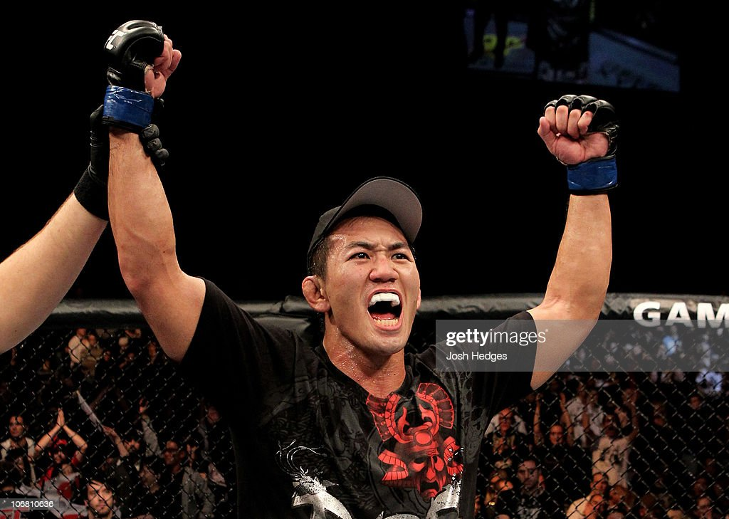 Yushin Okami of Japan celebrates his unanimous points victory over Nate Marquardt of the USA during their UFC Middleweight Championship Eliminator bout at the Konig Pilsner Arena on November 13, 2010 in Oberhausen, Germany.