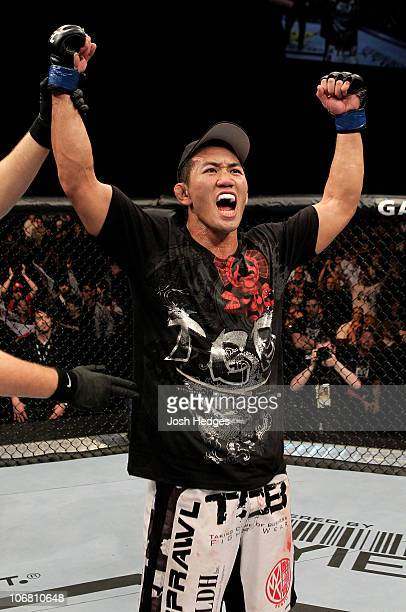 Yushin Okami of Japan celebrates his unanimous points victory over Nate Marquardt of the USA during their UFC Middleweight Championship Eliminator...