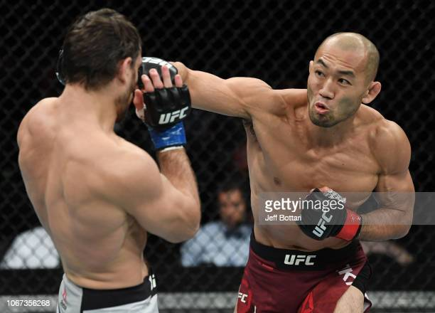 Yushin Okami of Japan punches Aleksei Kunchenko of Russia in their welterweight bout during the UFC Fight Night event inside Adelaide Entertainment...