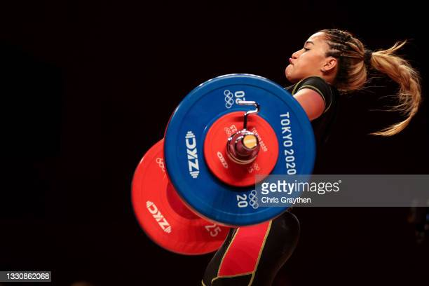 Yusleidy Mariana Figueroa Roldan of Team Venezuela competes during the Weightlifting - Women's 59kg Group A on day four of the Tokyo 2020 Olympic...