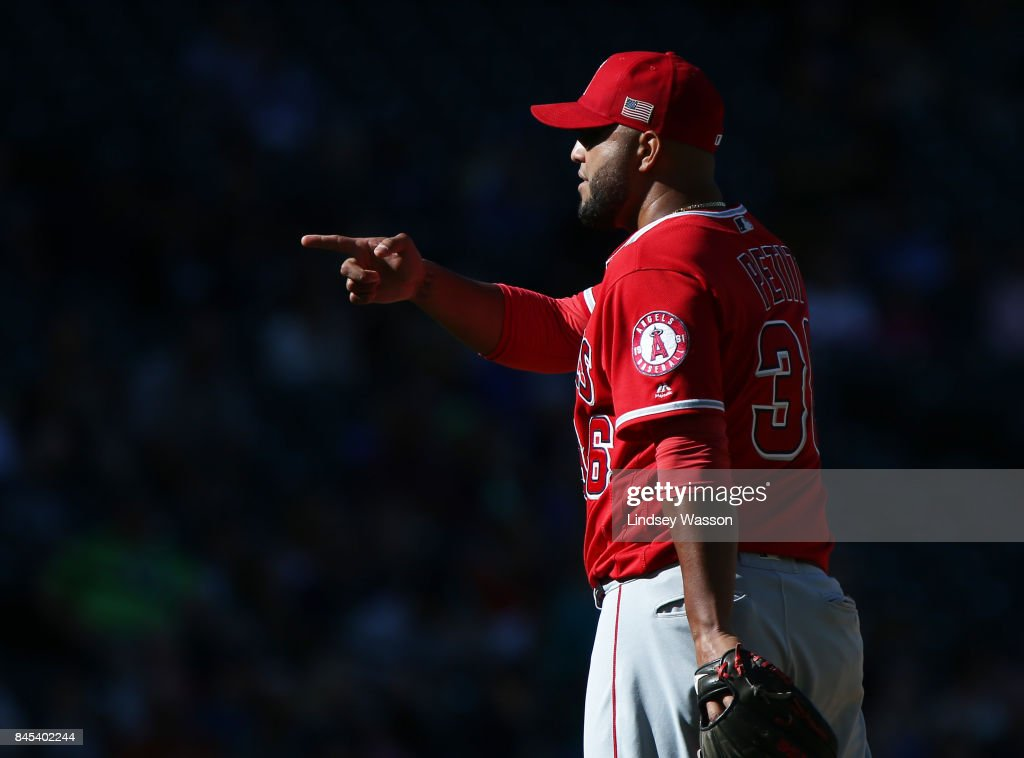 Yusmeiro Petit #36 of the Los Angeles Angels of Anaheim celebrates getting the final out against the Seattle Mariners to win 5-3 at Safeco Field on September 10, 2017 in Seattle, Washington.