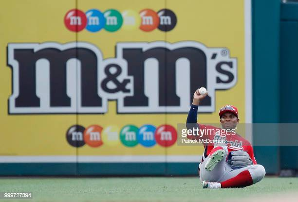 Yusniel Diaz of the Los Angeles Dodgers and the World Team cannot make a catch on a hit by Alex Kirilloff of the Minnesota Twins and the US Team in...