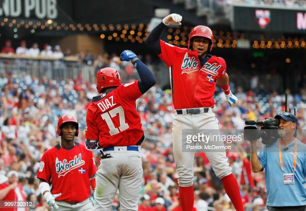 Yusniel Diaz of the Los Angeles Dodgers and the World Team celebrates after hitting a tworun home run with teammate Seuly Matias of the Kansas City...