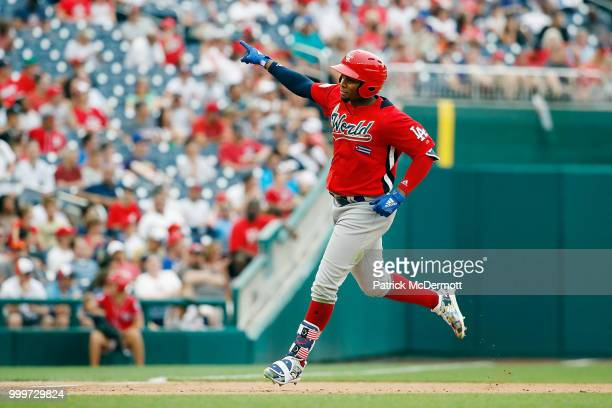 Yusniel Diaz of the Los Angeles Dodgers and the World Team rounds the bases after hitting a tworun home run in the fifth inning against the US Team...