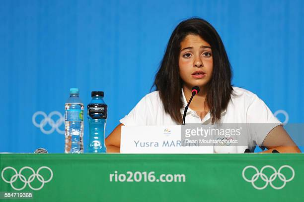Yusra Mardini, a Syrian swimmer, who now represents the team of Refugee Olympic Athletes speaks to the media at the Olympic Refugee Team Press...