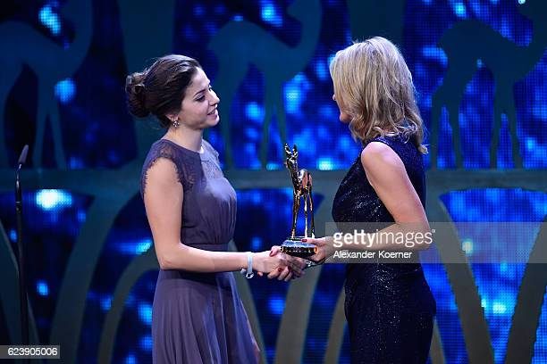 Yusra Mardini and Anja Reschke are seen on stage during the Bambi Awards 2016 show at Stage Theater on November 17 2016 in Berlin Germany