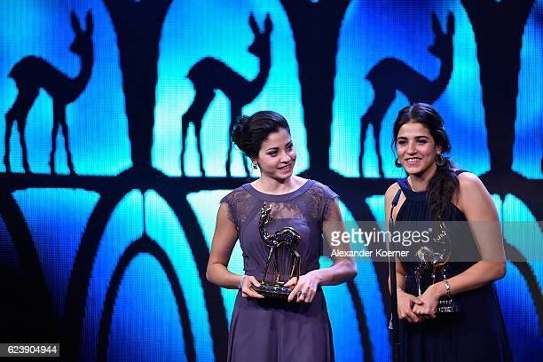 Yusra Mardini and Sarah Mardini are seen on stage during the Bambi Awards 2016 show at Stage Theater on November 17, 2016 in Berlin, Germany.