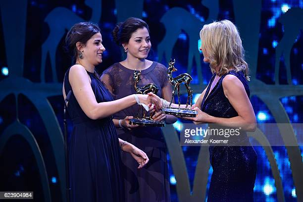 Yusra Mardini, Sarah Mardini and Anja Reschke are seen on stage during the Bambi Awards 2016 show at Stage Theater on November 17, 2016 in Berlin,...