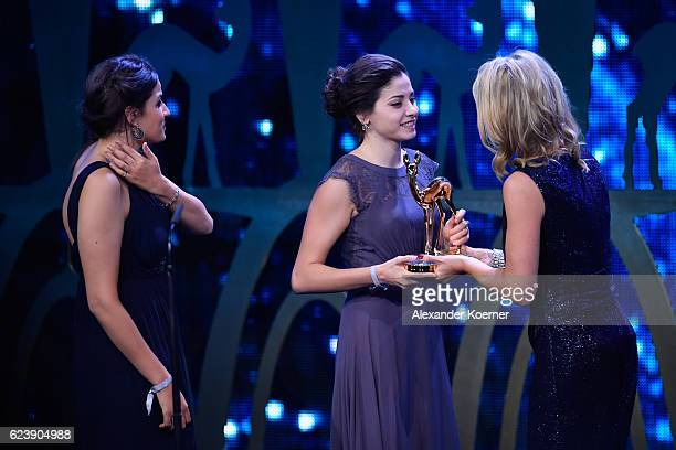 Yusra Mardini Sarah Mardini and Anja Reschke are seen on stage during the Bambi Awards 2016 show at Stage Theater on November 17 2016 in Berlin...