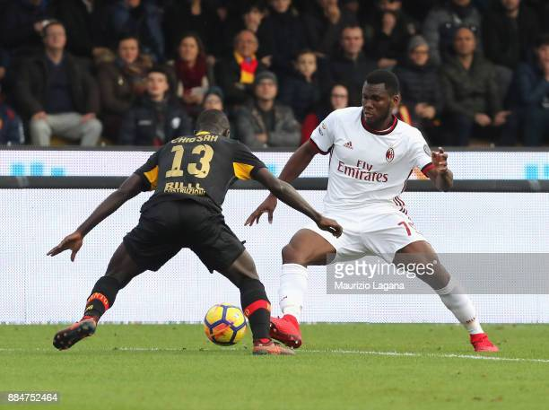 Yussif Chibsah of Benevento competes for the ball with Frank Kessie of Milan during the Serie A match between Benevento Calcio and AC Milan at Stadio...