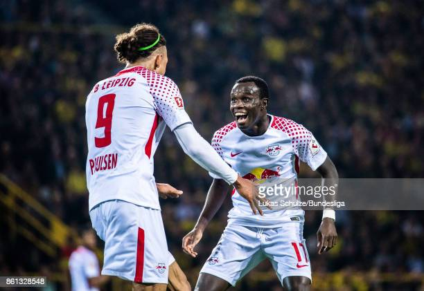 Yussuf Poulsen and Bruma of Leipzig celebrate their teams second goal during the Bundesliga match between Borussia Dortmund and RB Leipzig at Signal...