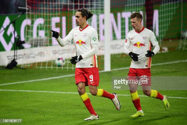 Yussuf Poulsen and Dani Olmo of RB Leipzig celebrate their team's second goal scored by Christopher Nkunku during the Bundesliga match between RB...