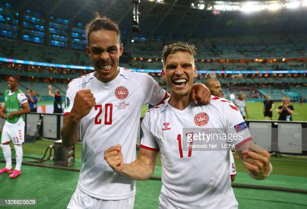 Yussuf Poulsen and Jens Stryger Larsen of Denmark celebrate their side's victory after the UEFA Euro 2020 Championship Quarter-final match between...