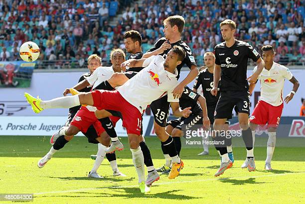 Yussuf Poulsen and Stefan Ilsanker of Leipzig challenge Enis Alushi and Daniel Buballa of St Pauli during the Second League match between RB Leipzig...