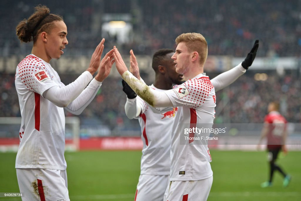 Yussuf Poulsen (L) and Timo Werner (R) of Leipzig celebrate during the Bundesliga match between Hannover 96 and RB Leipzig at HDI-Arena on March 31, 2018 in Hanover, Germany.